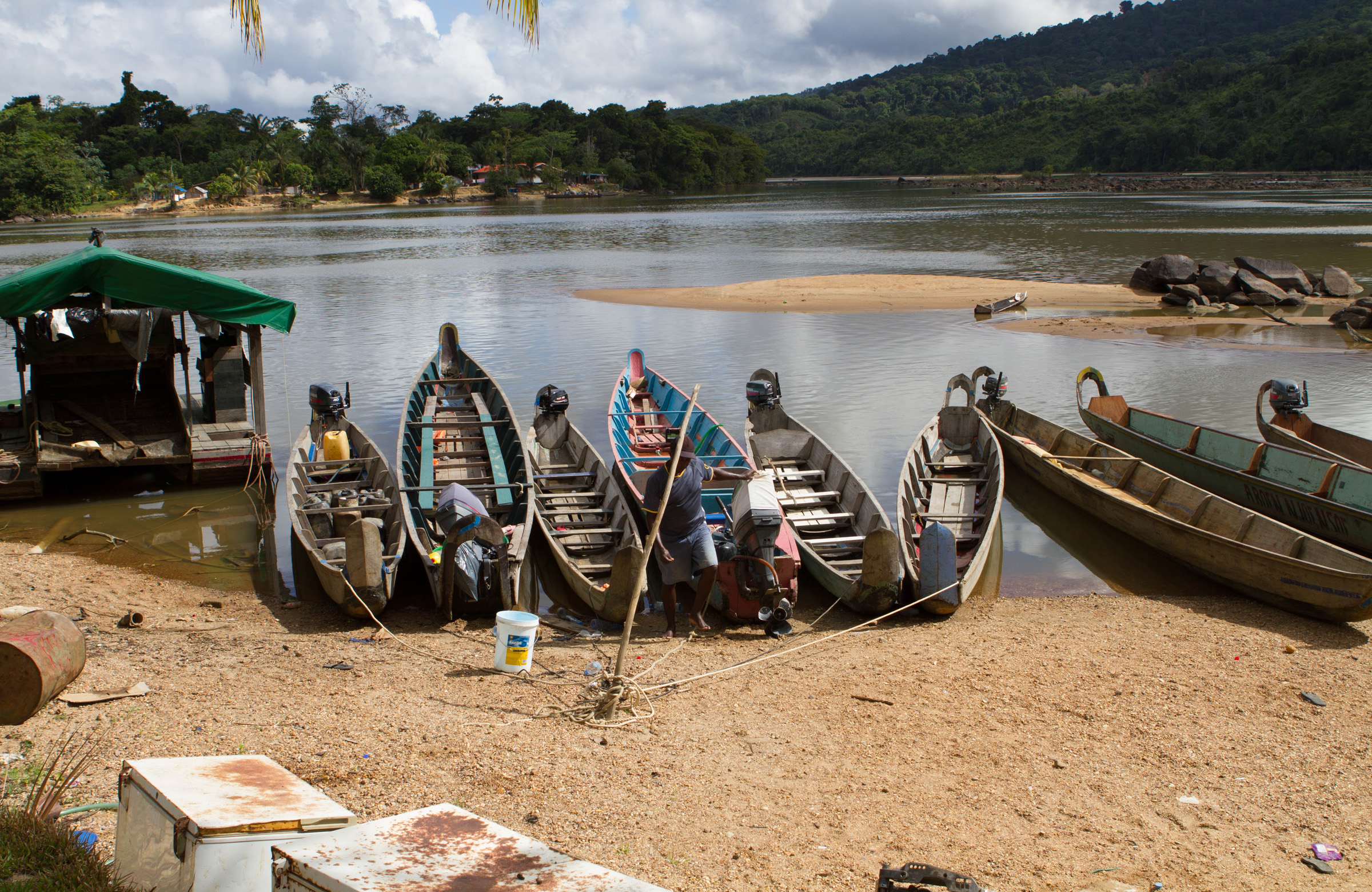 Boats by the river in Suriname - by W Mink