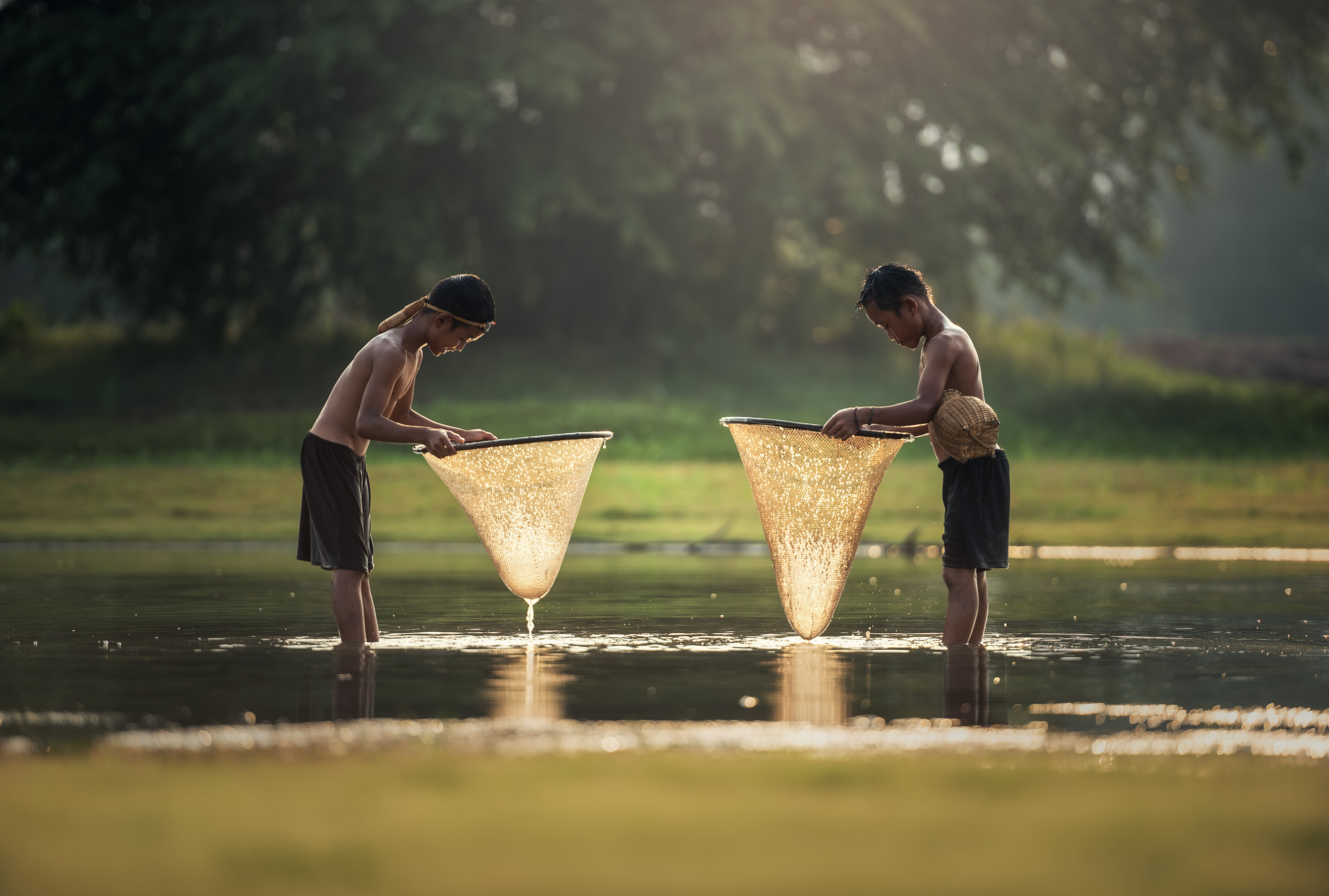 Boys fishing in the river, Cambodia - sasint
