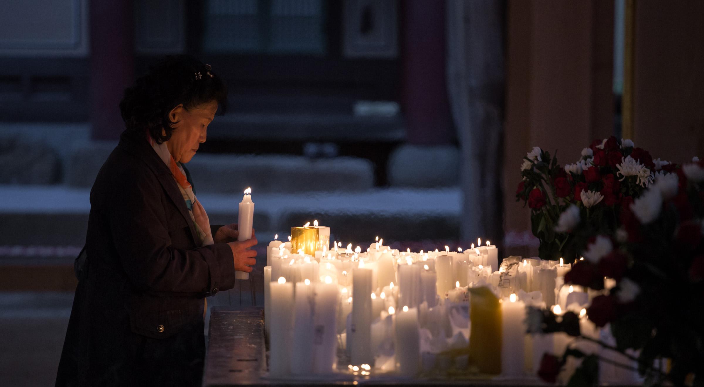 Prayer at dusk in Seoul, South Korea - by Brad Hammonds