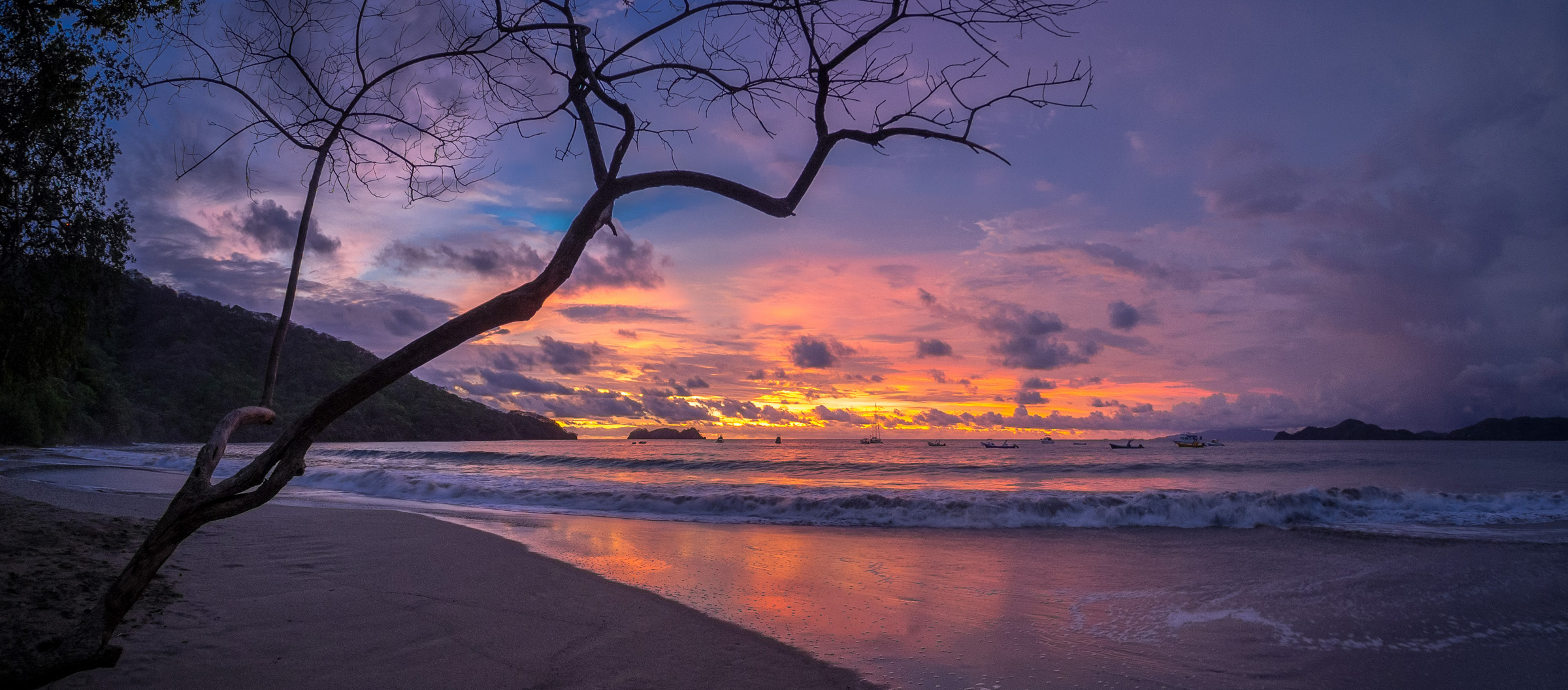 Sunset on Playa Hermosa, Costa Rica - by Norm Lanier