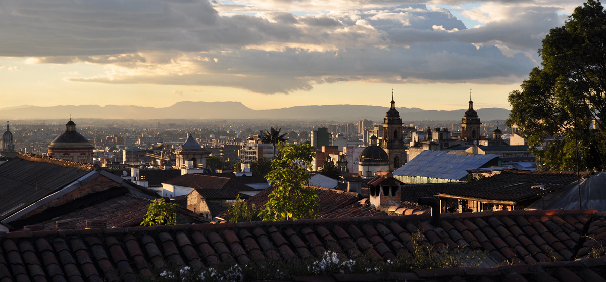 View across the rooftops in Bogotá, Colombia - by Javier Guillot