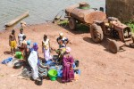 Buying fish in Bafata, Guinea-Bissau - by jbdodane
