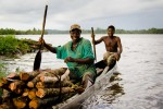 Crossing the river in Cestos, Liberia - by Cameron Zohoori