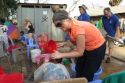 Volunteer washing children's hair in the slum