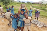 Children in Zimbabwe holding bricks