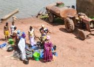 Buying fish in Bafata, Guinea-Bissau - by jbdodane