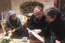 CWI missionary Aviel Sela doing a Bible study with two Soviet-background Holocaust survivors in Jerusalem