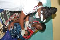 Nurse Beatrice with mother and baby - Zambesi Mission